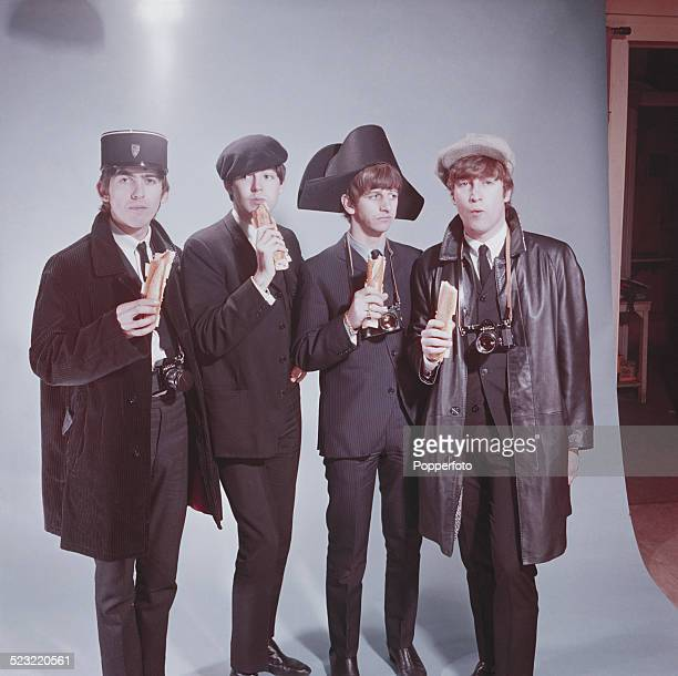 The Beatles posed wearing a variety of french hats including a kepi bicorne and beret and holding baguette sandwiches and Pentax cameras in Paris in...