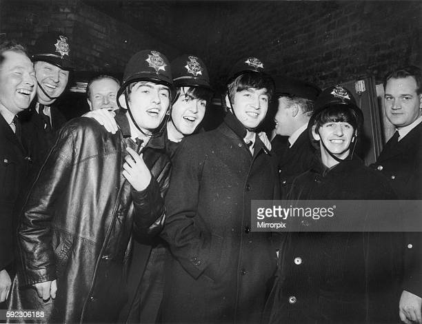 The Beatles wearing Policemen's helmets in Birmingham after concert at the Hippodrome Birmingham 10th November 1963 Evaluation Scan Only If you...