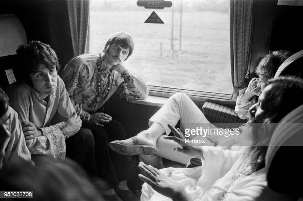 The Beatles with Marhirishi Yogi aboard a train bound for Bangor in North Wales 29th August 1967
