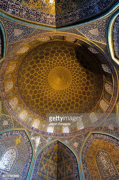 The beautiful and intricate tiled patterns on the dome of the Sheikh Lotfollah Mosque.