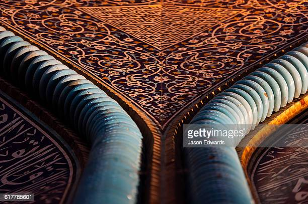 The beautiful and intricate tiled patterns on the wall of the Sheikh Lotfollah Mosque.