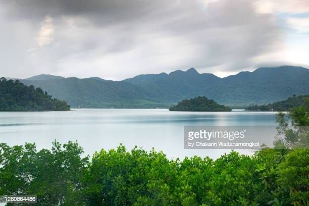 the beautiful bay of ko chang (koh chang) island with its small satellite islands. the green mangrove trees in the foreground with rainy cloud sky. - islands in the sky stock pictures, royalty-free photos & images