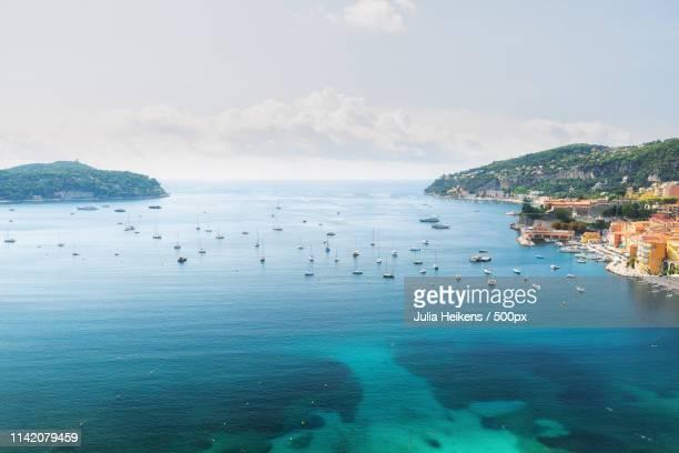 the beautiful bay of villefranche-sur-mer - saint jean cap ferrat stock pictures, royalty-free photos & images