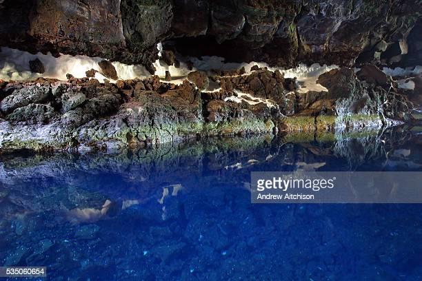 The beautiful blue water in the volcanic cavern of Los Jameos Del Agua in El Malpais de la Corona near the village of Haria Lanzarote Spain It was...
