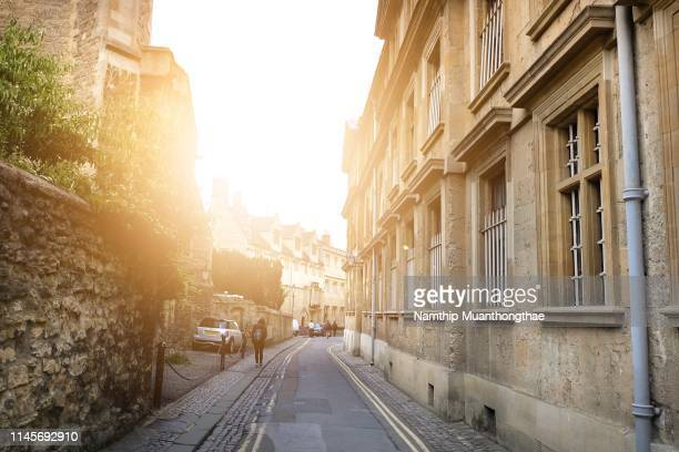 the beautiful building in oxford city with the small street. - cobblestone stock pictures, royalty-free photos & images