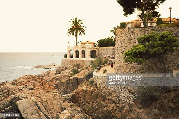 the beautiful cami de ronda (boardwalk) footpath of s agaro in the shoreline of mediterranean sea costa brava that connects sant feliu de guixols and platja d aro with beautiful architecture and nice views. - ronda stock pictures, royalty-free photos & images