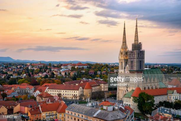the beautiful church in zagreb with the old buildings in old city among the sunrise in croatia, europe. - zagreb stock-fotos und bilder
