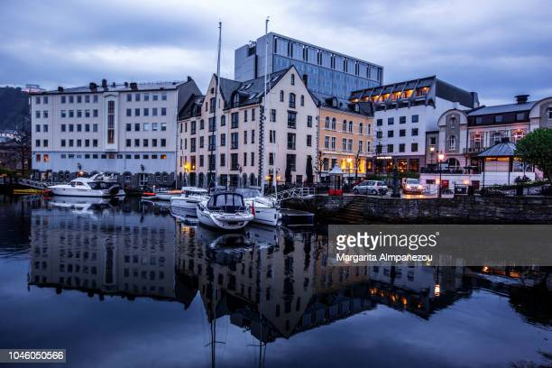 The beautiful city of Alesund and its reflection at dusk