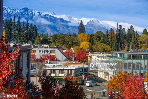 the beautiful colors of downtown queenstown in the fall. - queenstown stock pictures, royalty-free photos & images