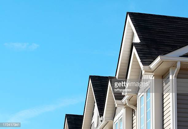 the beautiful dark roof of a new house - eaves stock photos and pictures