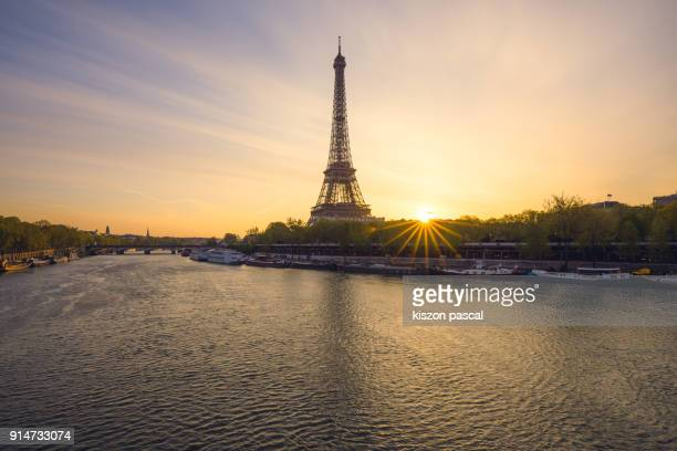 the beautiful eiffel tower and Seine river during sunrise