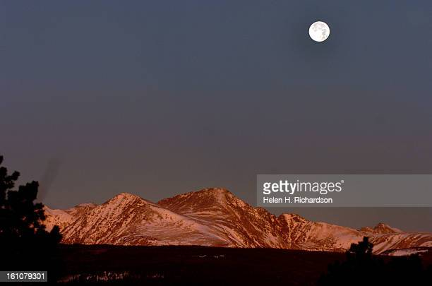 DECEMBER 5 2006 The beautiful full moon sets atop the Continental Divide PHOTO BY HELEN H RICHARDSON