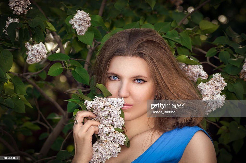 The beautiful girl in the wood with a lilac : Stock Photo