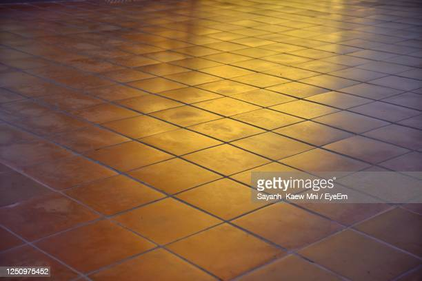 the beautiful golden light reflected on the tile floor creates a phenomenon on the tile surface. - light natural phenomenon stock pictures, royalty-free photos & images