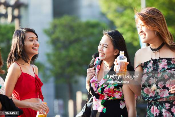 the beautiful indonesian women enjoying to talk - multiculturalism stock pictures, royalty-free photos & images
