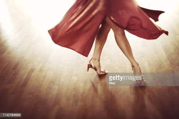 the beautiful legs of a dancing attractive woman - salsa dancing stock photos and pictures