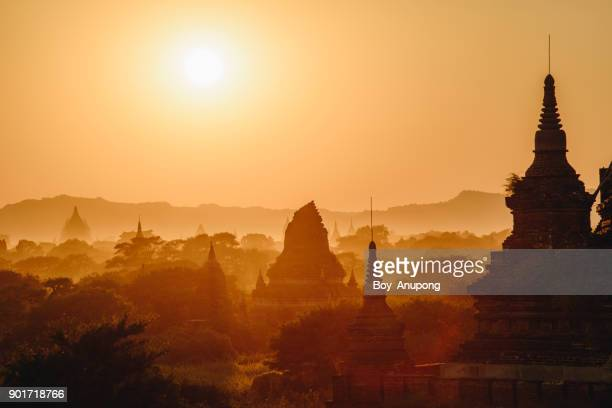 the beautiful scenery landscape of bagan plains at dawn. - myanmar culture stock pictures, royalty-free photos & images