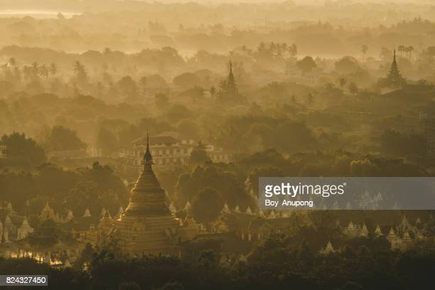 the beautiful scenery view of kuthodaw pagoda at dawn in mandalay, myanmar. - myanmar culture stock photos and pictures