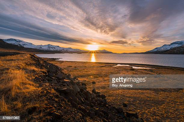 the beautiful sunset over the fjord of east iceland. - wide stock pictures, royalty-free photos & images