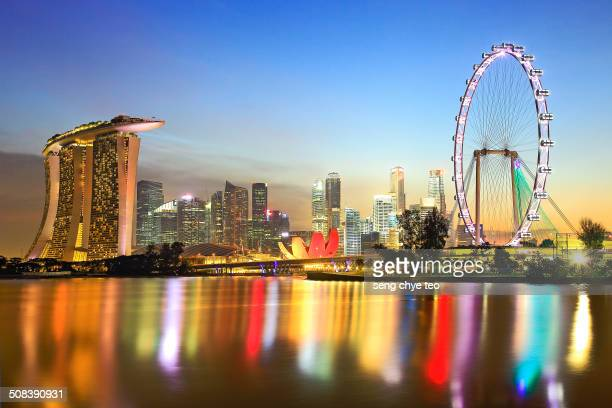 The beautiful sunset reflection seen at Marina Bay Waterfront Promenade with Singapore flyer.
