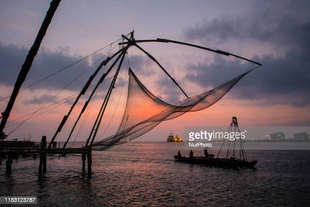 The beauty of the structure of the chinese networks during the hours of sunset in the port of quotFort Cochiquot In the city of Cochin Kerala state...