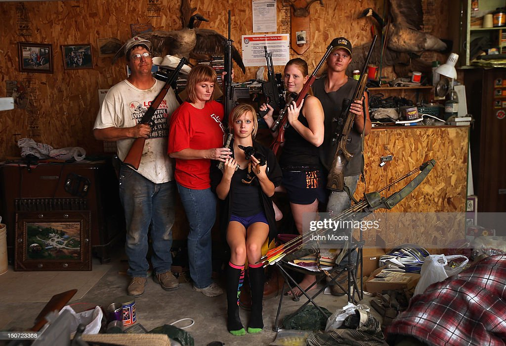 The Becker family, including Darren, his wife Dorthy and their children Renee 15, Katie, 17 and Charlie, 19, show off a small part of the family weapons collection, and their pet Mini Chihuahua, at the Becker farm August 24, 2012 in Logan, Kansas. During hunting season later in the year, the Beckers host guests from around to country. Like many Kansas farmers affected by the record drought, the Beckers are working hard to hang on to their farm, which has been in their family for five generations. Most of Kansas is still in extreme or exceptional drought, despite recent lower temperatures and thunderstorms, according to the University of Nebraska's Drought Monitor. The record-breaking drought, which has affected more than half of the continental United States, is expected to drive up food prices by 2013 due to lower crop harvests and the adverse effect on the nation's cattle industry.