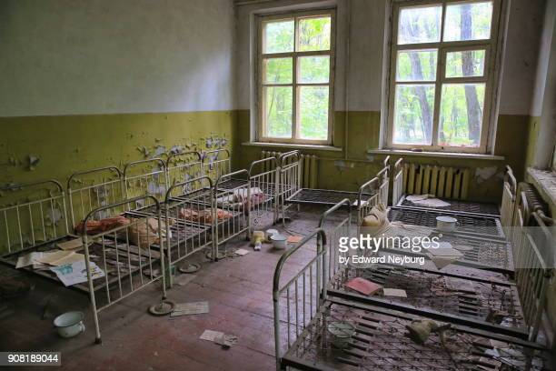 the bedroom in abandoned kindergarten within chernobyl exclusion zone - chernobyl stock pictures, royalty-free photos & images