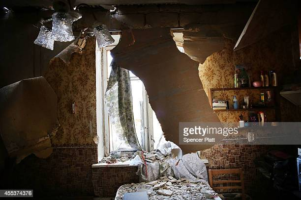 The bedroom room in a destroyed home is viewed in the battered city of Lugansk on September 13 2014 in Lugansk Ukraine Lugansk a separatist held city...