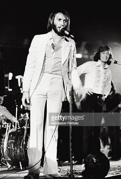 The Bee Gees band during a concert English brothers and musicians Robin and Maurice Gibb are singing together Rome 1970s