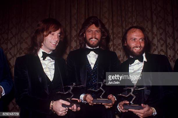 The Bee Gees Barry Robin and Maurice Gibb with awards circa 1970 New York