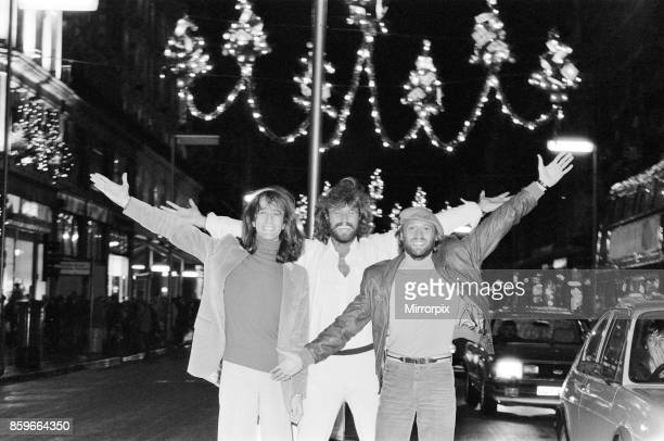 The Bee Gees check out the christmas lights in Regent Street London 22nd November 1981 From left to right Robin Gibb Barry Gibb Maurice Gibb
