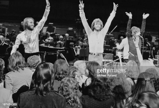 The Bee Gees on stage with an orchestra 1973 Left to right Maurice Barry and Robin Gibb