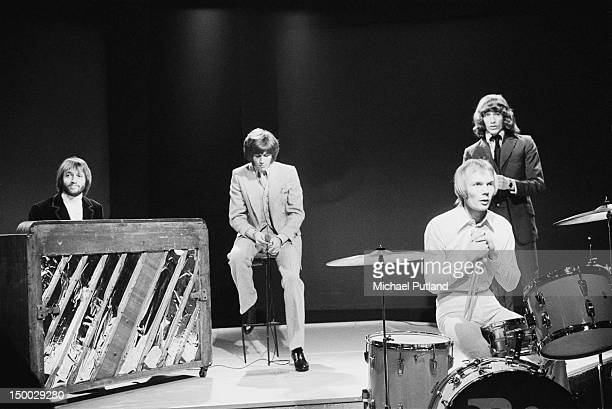 The Bee Gees performing on the BBC TV show 'Top Of The Pops' London 6th March 1969 Left to right Maurice Gibb Barry Gibb Colin Petersen and Robin Gibb
