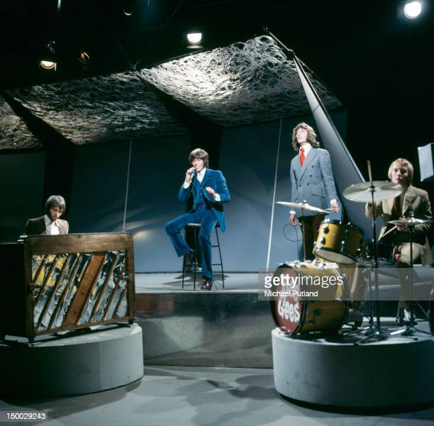 The Bee Gees performing on the BBC TV show 'Top Of The Pops' London 13th February 1968 Left to right Maurice Gibb Barry Gibb Robin Gibb and Colin...