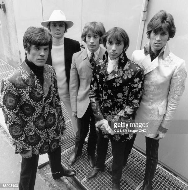 The Bee Gees pose for a group shot Vince Melouney Colin Petersen Robin Gibb Maurice Gibb and Barry Gibb outside a TV studio in 1968 in Hamburg Germany