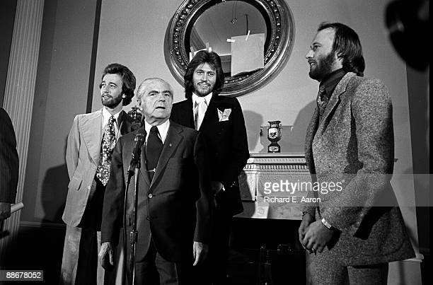 The Bee Gees Robin Gibb Barry Gibb and Maurice Gibb pose at Gold Disc presentation for Children of the World album in 1976 in New York