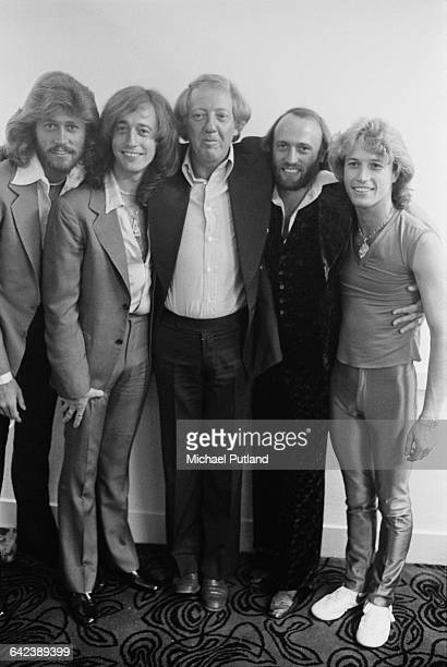 The Bee Gees with their younger brother Andy Gibb and manager Robert Stigwood at the NARM convention and award ceremony at the Diplomat Hotel in...