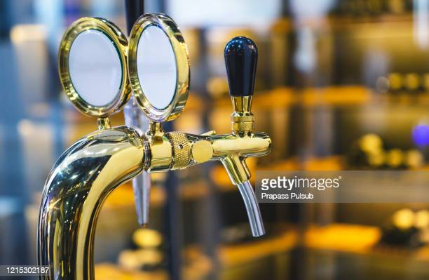 the beer taps in a pub. - ビールサーバー ストックフォトと画像