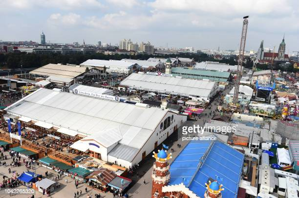 The beer tents at the Oktoberfest can be seen from the giant wheel with a cloudly rainless sky in MunichGermany 21 September 2016 The 183th Wiesn...