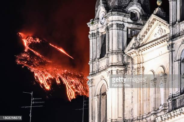 The beginning of the new eruption from the South - East crater of the Etna Volcano erupting with high lava fountains behind the Mother Church of...