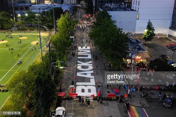 """The beginnings of a Black Lives Matter mural begins to take shape on East Pine Street in the so-called """"Capitol Hill Autonomous Zone"""" on June 10,..."""