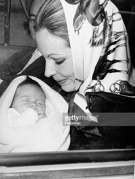 The Begum Aga Khan Princess Salina and formerly Lady James CritchonStuart at Heathrow Airport London with her baby daughter Princess Zahra on 11th...