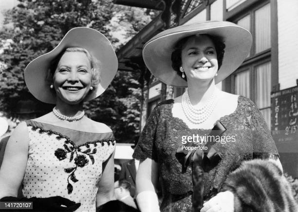 The Begum Om Habibeh Aga Khan widow of Shia Ismaili Muslim leader Aga Khan III at Chantilly Racecourse in Oise France with racehorse owner Madame...