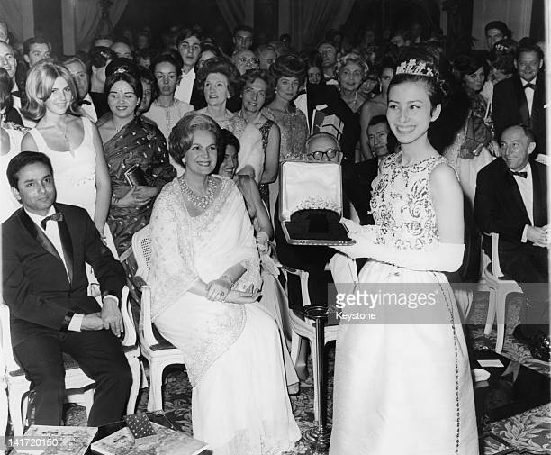 The Begum Om Habibeh Aga Khan widow of Shia Ismaili Muslim leader Aga Khan III presents a diadem to MarieClaude Abalain as First Prize at the...