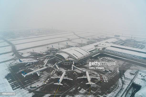 The Beijing Capital International Airport is covered with snow on November 22 2015 in Beijing China Snow fell in Beijing Tianjin Jilin and other...