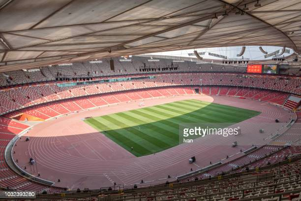 the beijing national stadium, aka the bird's nest, was designed for use throughout the 2008 summer olympics, beijing nest - 2008 summer olympics beijing stock pictures, royalty-free photos & images