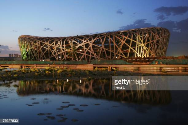 The Beijing National Stadium, also known as the bird's nest, is seen on July 10, 2007 in Beijing, China. The bird's nest will be the main track and...