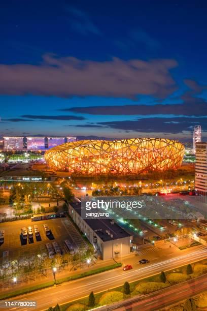 the beijing national stadium at night - stadio olimpico nazionale foto e immagini stock