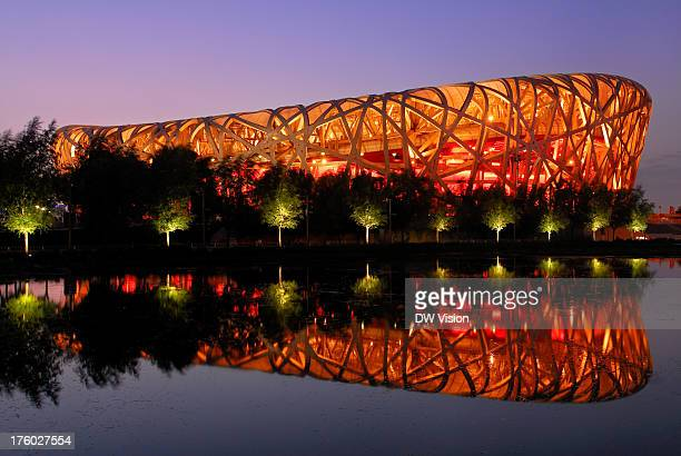 The Beijing olympic stadium stadium was design med by the architects Jacques Herzog and Pierre de Meuron and was finished just in time for the games...