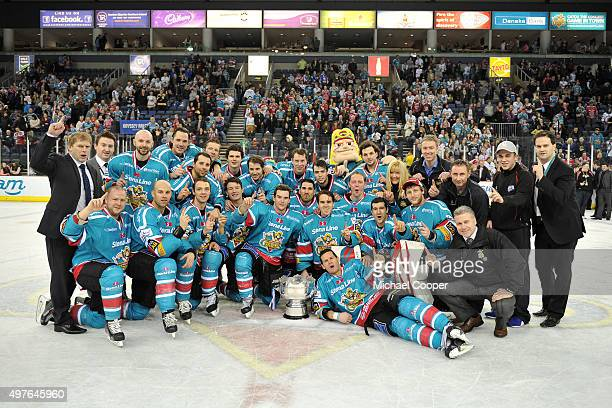 The Belfast Giants ice hockey team celebrates at the Odyssey Arena Belfast County Antrim Northern Ireland with the Montieth Bowl after the Belfast...